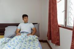 醒早晨的Â亚洲人 图库摄影