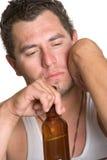 醺酒的沮丧的人 免版税库存图片