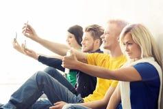 采取一selfie的小组行家在学校 库存图片