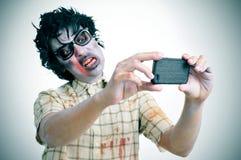 采取一selfie,与过滤器作用的蛇神 免版税库存图片