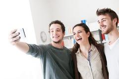 采取与一个手机的少年selfies 库存照片
