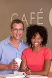 采取咖啡休息的学员 免版税图库摄影