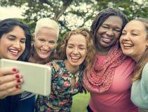 采取图片概念的小组妇女 库存图片