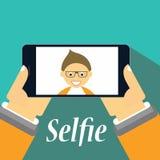 采取在他的智能手机的男孩一selfie 库存照片