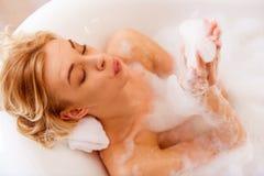 采取妇女的浴 库存图片