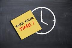 采取您的与闹钟的时间概念在校务委员会 库存照片