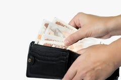 采取捷克金钱的人在钱包外面 库存图片