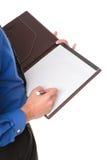 采取文字的空白生意人记事本附注 免版税库存图片