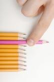 采取桃红色铅笔 图库摄影