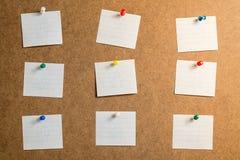 采取的笔记九个白色贴纸关于纸板背景 库存图片