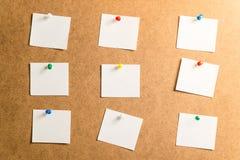 采取的笔记九个白色贴纸关于纸板背景 免版税库存照片