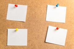 采取的笔记四个白色贴纸关于纸板背景 库存图片