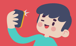采取Selfie的逗人喜爱的男孩 库存图片