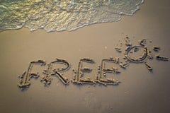 释放在海滩的沙子 免版税库存照片