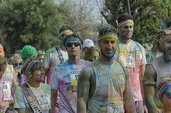 里米尼颜色奔跑的赛跑者在种族以后的 库存照片