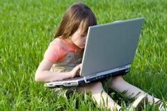 里面儿童计算机 免版税库存图片