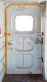 里面军用飞机的门 库存图片