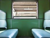里面火车和椅子 免版税库存照片