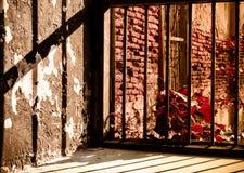 从里面观看的老监狱窗口 概念 免版税图库摄影