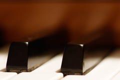 重点锁上浅的钢琴 库存照片