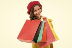 重的袋子 u 一点顾客 有纸袋的小孩子 女孩孩子喜欢购物 免版税库存图片