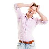 重音和头疼概念-举行他的顶头screami的年轻人 免版税库存图片