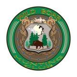 野公猪狩猎俱乐部徽章在平的样式的传染媒介例证 免版税库存照片