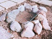 野营的BBQ由石头制成 免版税库存照片