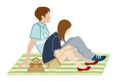 野餐夫妇-侧视图 库存照片