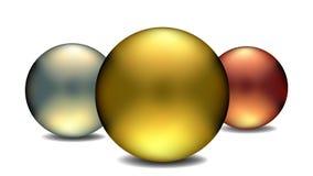 金、银和古铜地球 库存图片