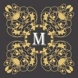 金与信件m的组合图案框架在黑暗 免版税库存照片