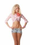 金发碧眼的女人吃糖甜点 图库摄影