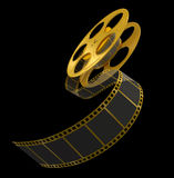 金在黑色的影片小条 免版税库存照片