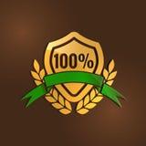 金子与绿色丝带的质量标志 免版税库存图片