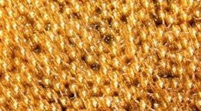金子发光的闪烁背景 免版税库存图片