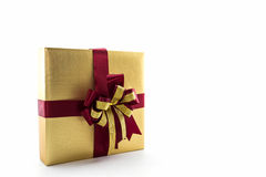 金子和棕色礼物盒有丝带的鞠躬 库存照片