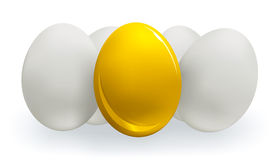 金子和白鸡蛋 图库摄影