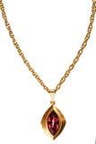 金子和红宝石垂饰在链子 免版税图库摄影