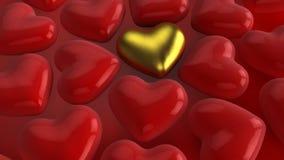 金子和红色心脏 免版税库存图片