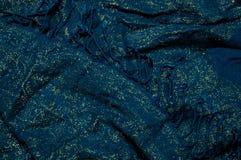 金子和蓝色织品有边缘背景 库存照片