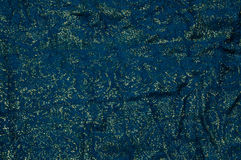 金子和蓝色织品背景 免版税库存图片