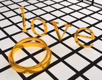 金子婚戒和爱 库存照片