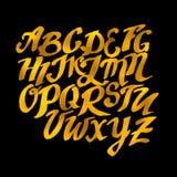 金子手拉的字母表样式 传染媒介Eps10例证dood 免版税库存照片