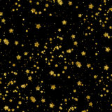金子担任主角虚假箔金属星黑色背景 库存图片