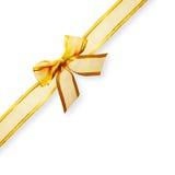 金子渐近的丝带和弓 免版税库存照片