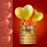 金子般的心和红色与透明丝带 库存图片