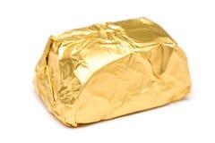 金子被包裹的巧克力糖 免版税库存照片