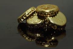 金子装瓶上面 免版税库存照片
