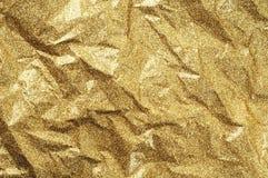 金子起皱纹的纸纹理摘要背景 免版税库存图片