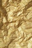 金子起皱纹的纸纹理摘要背景 库存图片